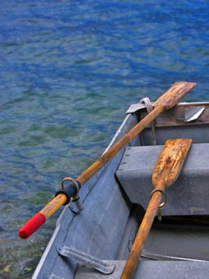 metal row boat with wooden oars