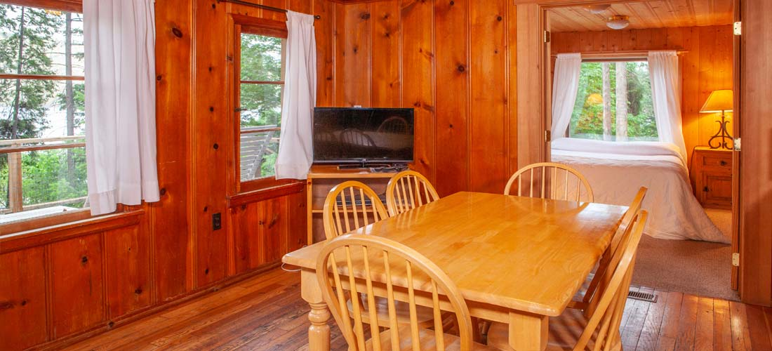 cabin dining and view into bedroom
