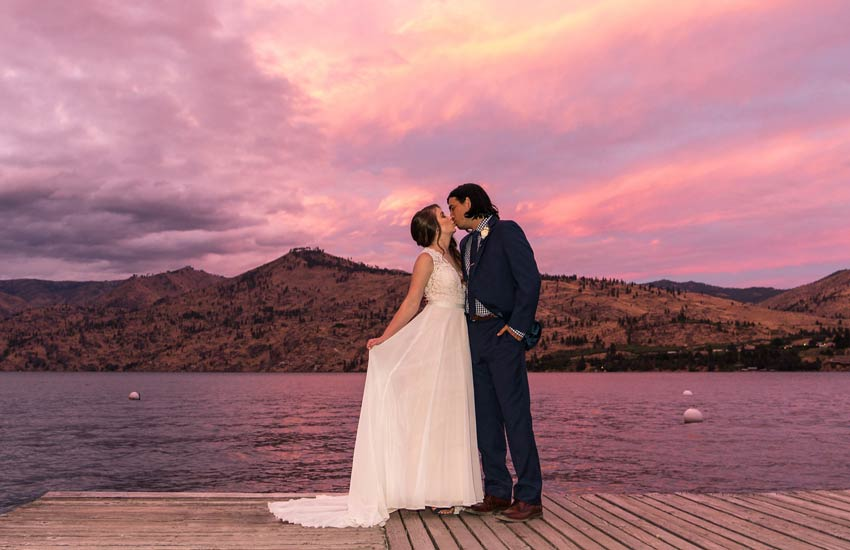 Bride and Groom on dock at Kelly's Lake Chelan wedding venue