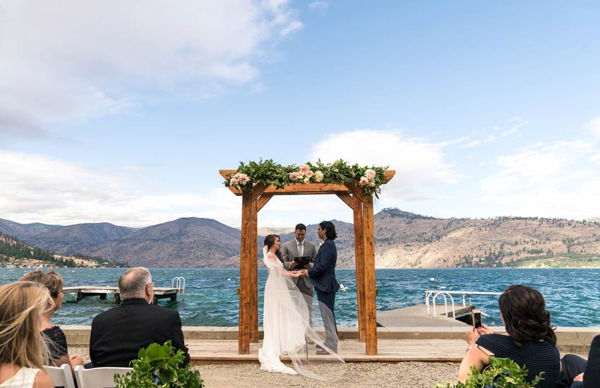 bride on dock at Kelly's Lake Chelan wedding venue